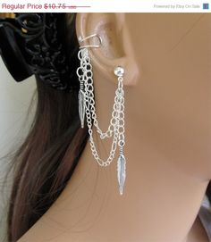 Ear Cuff With Silver Feather And Chains. $9.68, via Etsy.