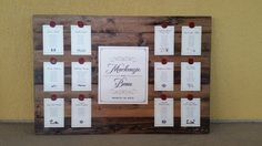 "This seating board project for Mackenzie and Beau's wedding at Cypress Grove Estate House was super fun! We built and stained a wooden backdrop on which we hung lists of guests by table, accented with custom wax seals that we had made for the couple's wedding invitation. We created a unique ""logo"" for each table, based on a location to which the couple has traveled together. This was a truly amazing wedding planned by Blush by Brandee Gaar."