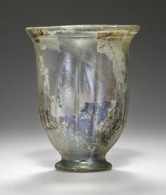 Beaker. Artist/Maker(s): Unknown. Culture: Roman. Place(s): Workshop in the Eastern Mediterranean, Eastern Mediterranean (Place created). Date: 1st - 2nd century. Medium: Glass.