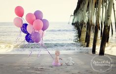Because the only way to celebrate your birthday is with your very best friend. <3 LotusLily Photography | Child Photography | Child Photographer | One Year Old Picture | Wilmington Photographer | Carolina Beach Photographer | Winston-Salem Photographer | Balloons on the Beach | Best Friends