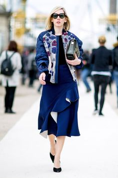 - A bomber jacket and a ruffled midi skirt are a playful combo.