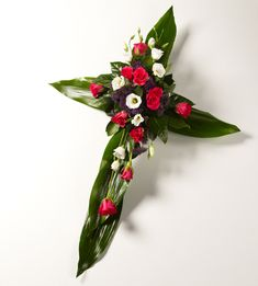 Funeral cross | http://www.mementoflowers.com/top-categories/sympathy-flowers