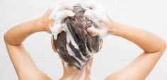 Woman washing her hair | Make Any Conditioner Leave-In With This DIY Recipe
