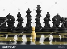 Self confidence white peon standing in front of a black chess army before confrontation.