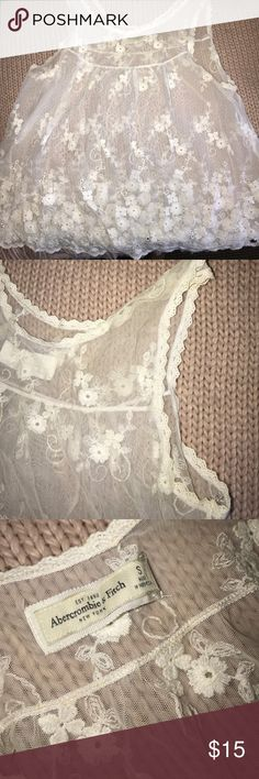 Abercrombie and Fitch white Tank This feminine embroidered price is perfect for any wardrobe! Size S. in good condition Abercrombie & Fitch Tops Tank Tops
