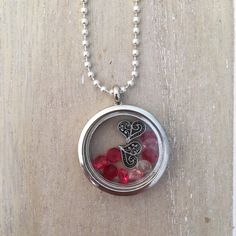 Long silver colored ballchain necklace with magnetic glass locket, red glass stone diamonds and heart charms