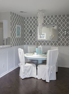 I have this table and chair set, love the idea of covering the chairs like this. Softens up the entire dining room