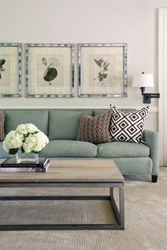 Tobi Fairley - Chic living room with botanical prints in silver frames, green sofa, oil ...