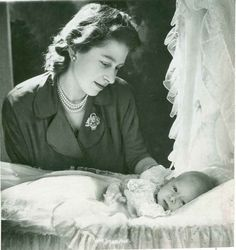 Queen Elizabeth, still just a princess, looks down at her firstborn son, Charles, six weeks after he was born Nov. 14, 1948.