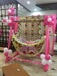 Amazing cradle ceremony decoration ideas for all your events. images for cradle decoration for naming ceremony from Quotemykaam catalogue. Naming Ceremony Decoration, Wedding Hall Decorations, Marriage Decoration, Festival Decorations, Ceremony Decorations, Balloon Decorations, Birthday Decorations, Flower Decorations, Cradle Decoration
