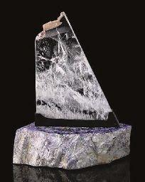 A quartz on charoite sculpture,