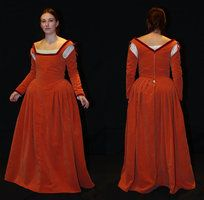 A Renaissance dress made of red-orange velvet with red velvet ribbons, in the back eyes and hooks for closing, the sleeves are removeable. The bodice is stiffened with buckram.~Celefindel
