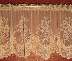 "ALICIA is a fancy floral bouquet pattern that we import from Austria.  It is a fine quality valance that will enhance a formal decor that will grace the finest of homes.  ""Alicia"" Valance comes in a 15"" height and the Tiers are available in 23"" and 35"" lengths.  Fits up to 1/2"" diameter rods.  No sewing necessary.  This pattern is available in  Champagne (Ecru) and White.  100% washable poly."
