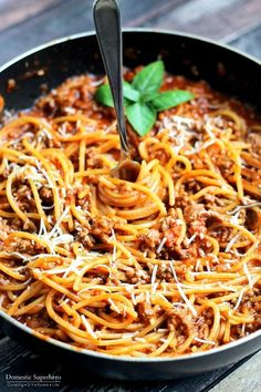 You gotta love a dish that can easily fluctuate between gourmet and casual like this spaghetti with meat sauce.