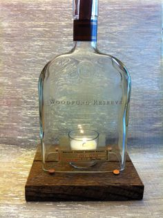 this is a fantastic idea. Cut out the bottom of a Woodford Reserve bottle. They come in beautiful shapes. You can always find someone to drink the bourbon or rye, can't you? Diy Bottle, Bottle Art, Bottle Crafts, Diy Home Crafts, Handmade Crafts, Bourbon Bar, Woodford Reserve, Bottom Of The Bottle, Bottle Cutting