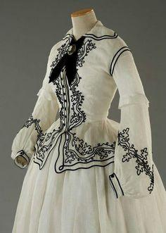White with black detailing, perfection.   Tirelli Costumi