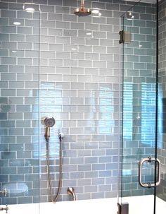 Ocean Blue Grey Glass Subway tiles in gorgeous modern shower. https://www.subwaytileoutlet.com/products/Ocean-Glass-Subway-Tile.html#.VLgy_CvF-1U