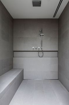 Shower with built in shelf and seat in natural finish tile at Maleela master ensuite