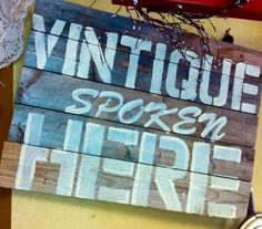 Hand stenciled on 100 year old barn wood.