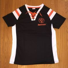 """Brand New Women's Jagermeister Top Brand new women's Jagermeister top. Orange lace up v-neck front and orange """"Jagermeister 56 Yard Line"""" logo on back. Available in sizes S/M or M/L. Tops Tees - Short Sleeve"""