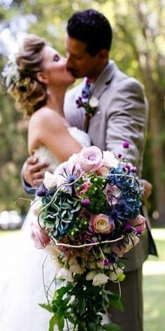 English garden inspired lux bridal bouquet in pinks and purples