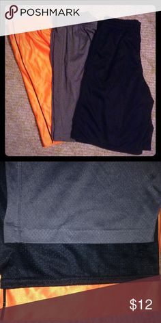 Boys shorts Bundle of 3 basketball shorts. Black shorts are Starter brand with pockets, elastic waist, L(10/12). Gray shorts are Tek Gear with pockets, elastic waist with inner drawstring, and are engineered with DryTEK technology, M(10/12). Orange shorts have a slim black stripe down each side, are Athletech brand, elastic waist, L(10/12). All 3 are 100% polyester. Only orange shorts are NWT, but others are like new. Multiples Bottoms Shorts