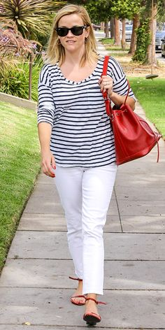 Street Style File: Reese Witherspoon was decked out in red, white and stripes. She paired a striped Splendid top with white jeans, a red bag and matching strappy sandals. #InStyle