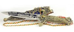 Eastern Dragon athame by Sage Cauldron. $23.96. This highly ornate athame is decorated with a faux brass hilt, as well as a faux brass sheath. Both the handle and the sheath are decorated with intricate patterns of knotwork and leaves, presenting a more elegant appearance than most bladed tools. The sheath also comes adorned with a long, braided red tassel, in a style similar to many other eastern blades, that can be used to fasten it to a belt and locks the knife in place so tha...