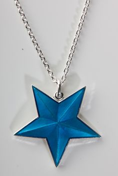 Enamel star necklace by Camilla Prytz