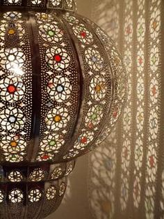 gorgeous moroccan lantern!! maybe one like this with a few smaller, bright ones