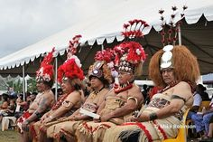 Five Matai (chiefs) with traditional headdress watch the cultural performances on day five of Samoa's celebrations of 50 years of being an i...