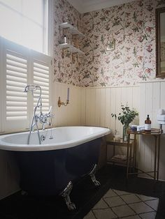 Cole and Son Hummingbirds Wallpaper In The Bathroom On The Bathroom Walls. Boutique Hotel Before and After. Blue Claw Foot Bath. Ikea Hack Cabinet. Vintage Bathroom Style. Wooden Shutters.