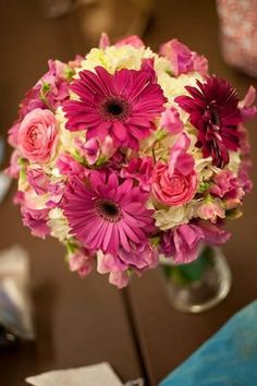 fuchsia gerber daisies, small pink roses, sweet peas and white hydrangea wedding bouquet by TinyCarmen