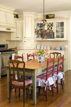 love the blue and white dishes on the counter with the red on the chairs...