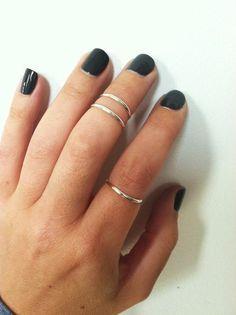 midi rings and dark nails