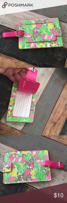 Lilly Luggage Tag NWOT Lilly luggage tag. In pink, green and yellow lemon print! Please ask any questions! 💕🍋 Lilly Pulitzer Accessories