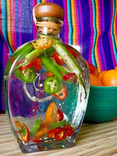Looking for a spicy cocktail? Try infusing tequila with peppers straight from your garden. Get the steps from HGTV.com, plus a recipe for a blood orange Sol de Flare cocktail.