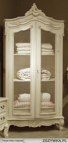 Beautiful Armoire With Wire Mesh Doors For A Linen Cabinet