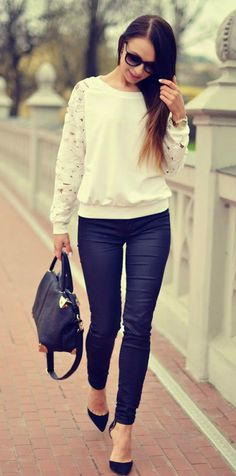 Gorgeous white cream lace sleeve blouse and black leather cute jeans and cute black leather hand bag and black nude pumps the best way to show fashion & style