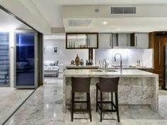 white kitchen. white kitchen open to dining room. white kitchen