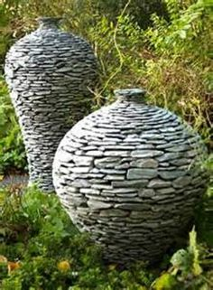 tufa & stone urns. I wonder if this can be made with wire mesh shaped into urns!!