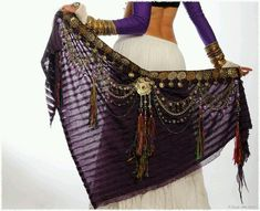 Tassels and medallions on longer scarf