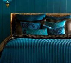 Dark Teal paint, and blues/aquas/teals bedroom sets.      http://bedroomdesigndecor.blogspot.com/2011/08/black-teal-bedroom-dark-teal-decorating.html