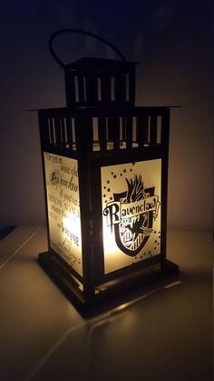 Also available in LARGE size lantern: https://www.etsy.com/listing/462577951/large-harry-potter-inspired-hogwarts  Show your house pride with this charming Ravenclaw inspired lamp!  Each side or this sturdy metal and glass lamp shows a picture or quote that defines the house of Ravenclaw. The Hogwarts Crest, Ravenclaw House Crest, Ravenclaws Lost Diadem, and part of the Sorting Hats poem. Each plate is hand decaled with lasting weather resistant permanent vinyl and is safe for indoor use or…