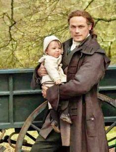 Jamie holds his grandchild, Jeremiah (Jemmy) Outlander Novel, Outlander Season 4, Outlander Quotes, Outlander Casting, Sam Heughan Outlander, Gabaldon Outlander, Fraser Clan, Jaime Fraser, Starz Series