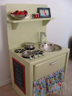 DIY Play Kitchen Round Up | - lots of repurposing of old furniture into cute kitchen for kids