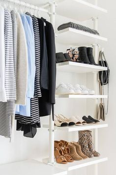 Shoes are beautifully displayed on stacked modular shelves beside a clothing rail holding clothes organized by color in this beautiful walk in closet.