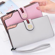 Item Type: Wallet Interior: Interior Compartment,Photo Holder,Cell Phone Pocket,Interior Zipper Pocket,Interior Slot Pocket,Note Compartment,Card Holder Wallet Length: Long Gender: Women Lining Material: Polyester Closure Type: Zipper Item Width: 10cm Item Weight: 200 Brand Name: fengzhizi Item Length: 19.5cm Material Composition: PU Pattern Type: Solid Model Number: D02 Style: Business Wallets: Standard Wallets Main Material: PU Item Height: 2cm