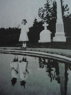 The pond in the cemetery showed a time not long ago when the grave with the cross was not there and there were actually two girls in white dresses.