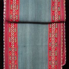 """A """"manta larga"""" from Chinchero, Peru. A long manta is not traditional but is a popular item for sale as """"runner."""" These """"runners"""" go very well in houses with oriental rugs and a variety can be seen on the Center's Cusco web site. (From the collection of Elizabeth VanBuskirk.)"""